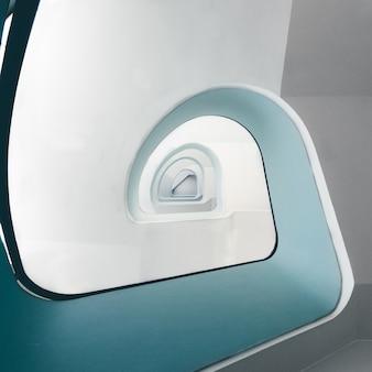 Vue grand angle d'un escalier en colimaçon moderne sous les lumières
