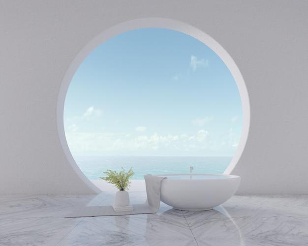 Vue sur la mer depuis la fenêtre circulaire avec baignoire