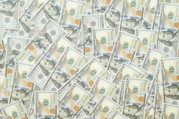 Vue rapprochée des factures de dollars en argent comptant en montant. vue rapprochée des billets de banque en argent comptant en dollars fond de billets de montant. concept de crise financière mondiale