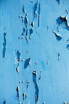 Vue de la texture d'une plaque de métal bleue avec de la peinture peelad.