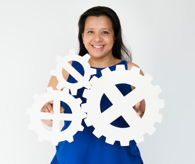 Woman hold gears collaboration team ensemble