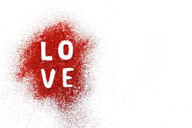 Word love sur le sable coloré