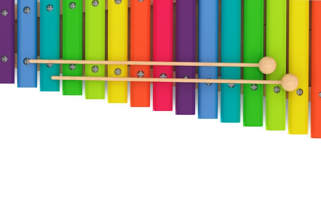 Xylophone en bois coloré avec maillets sur fond blanc