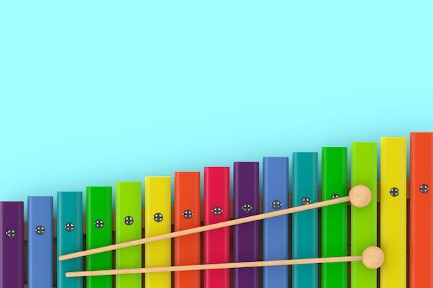 Xylophone en bois coloré avec maillets sur fond bleu. rendu 3d