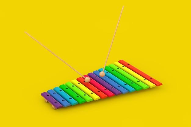 Xylophone en bois coloré avec maillets sur fond jaune. rendu 3d