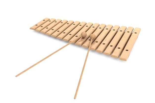 Xylophone en bois avec maillets sur fond blanc