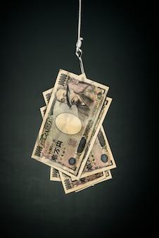 Yen argent sur le crochet