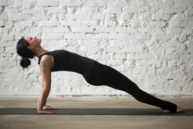 Young yogi attractive woman in purvottanasana pose, loft blanc b