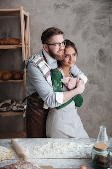 Younh couple hugging in kitchen