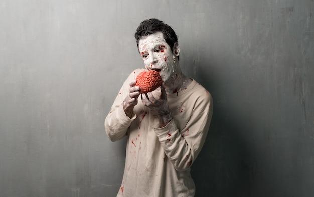Zombie terroriste mangeant un cerveau.