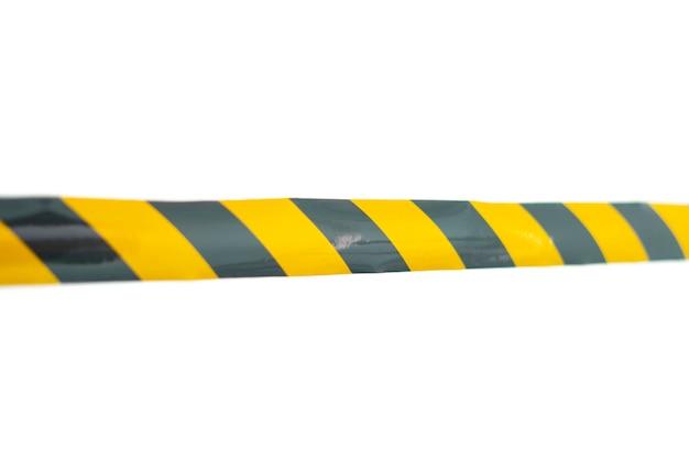 Une zone de ligne d'avertissement de la police, ne pas traverser, avertissement de sécurité tabe noir et jaune