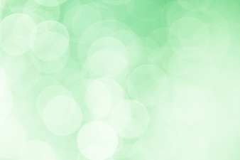 Bokeh blanc sur fond vert