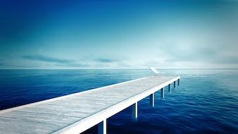 Chaise longue blanche et jetée en bois sur la plage tropicale avec la mer bleue et le ciel