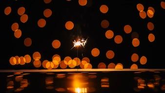 Cierge et taches de lumière