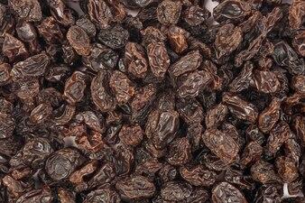 Fond de texture raisins secs biologiques, cassis
