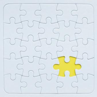 Maquette de puzzle avec pièce jaune.