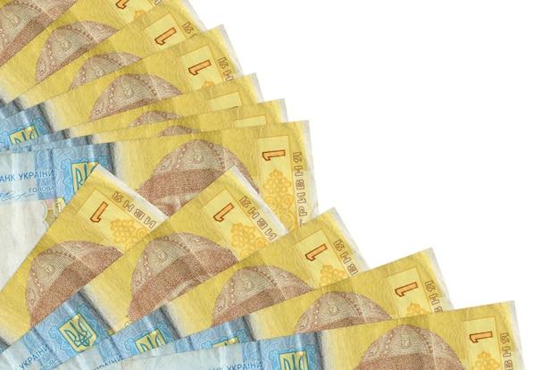 1 bollette grivna ucraina si trova isolato su sfondo bianco con spazio di copia impilati nella fine del ventilatore