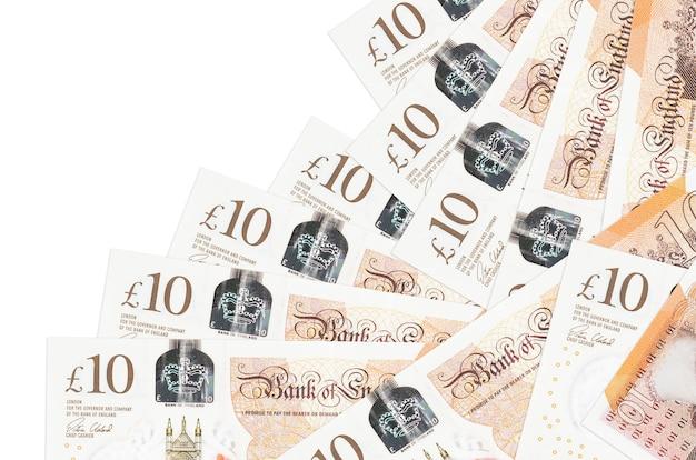 10 banconote in sterline britanniche si trovano in un ordine diverso isolato. attività bancarie locali o concetto di fare soldi.