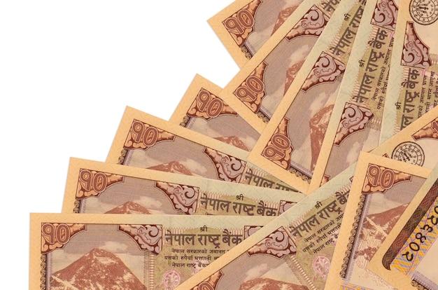 10 banconote in rupie nepalesi si trovano in un ordine diverso isolato su bianco. attività bancarie locali o concetto di fare soldi.
