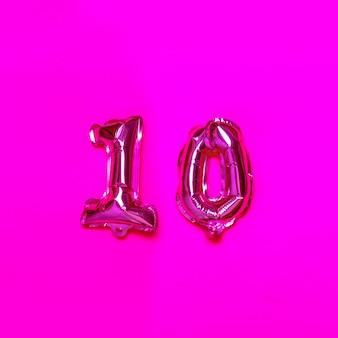 Palloncino elio 10 numeri su sfondo rosa. complimenti.