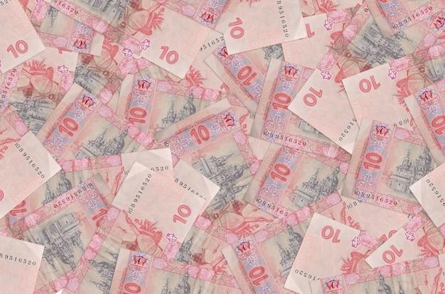 10 banconote hryvnias ucraine si trovano in una grande pila. . grande quantità di denaro