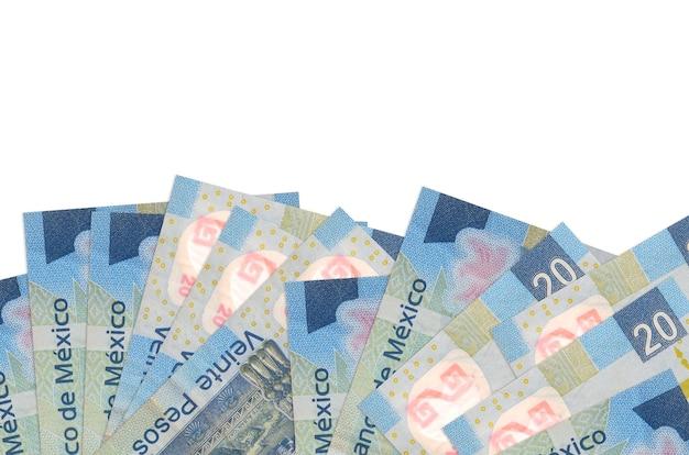 20 pesos messicani fatture si trova sul lato inferiore dello schermo isolato sul muro bianco con spazio di copia.