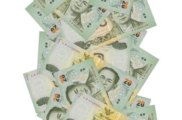 20 banconote baht tailandesi che volano giù isolate su bianco. molte banconote che cadono con lo spazio bianco della copia sul lato sinistro e destro