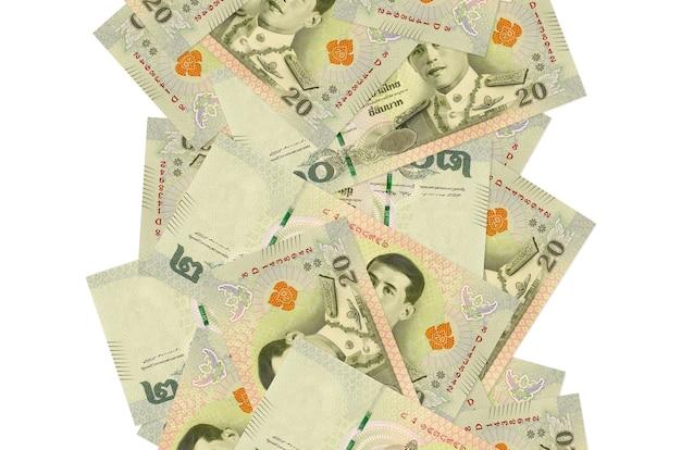 20 fatture di baht tailandesi che volano giù isolate su bianco. molte banconote che cadono con lo spazio bianco della copia sul lato sinistro e destro