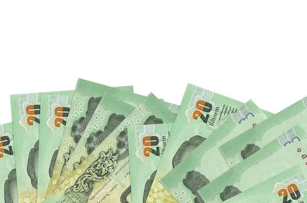 20 banconote in baht thailandesi si trovano sul lato inferiore dello schermo isolato. modello di banner di sfondo per concetti di business con i soldi