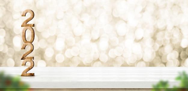 2022 felice anno nuovo numero legno (rendering 3d) su tavolo in legno bianco con parete bokeh oro scintillante e primo piano foglia sfocata, lasciare spazio per la visualizzazione del prodotto durante le vacanze di natale e capodanno