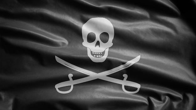 3d, trama del tessuto del teschio pirata con bandiera sciabola che fluttua nel vento. simbolo del pirata calico jack per il concetto di hacker e ladro. bandiera realistica dei pirati nera su superficie ondulata