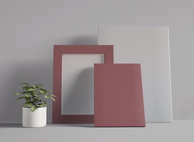 Illustrazione 3d. mockup di foto cornice vuota e due tela.