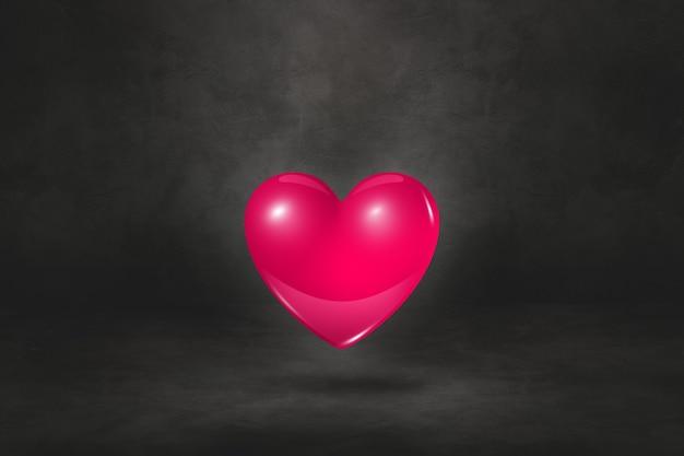 Cuore rosa 3d isolato su uno sfondo nero studio. illustrazione 3d