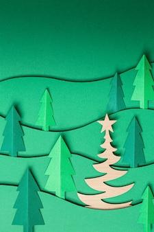 3d pop fuori il materiale illustrativo di carta degli alberi di natale sul verde