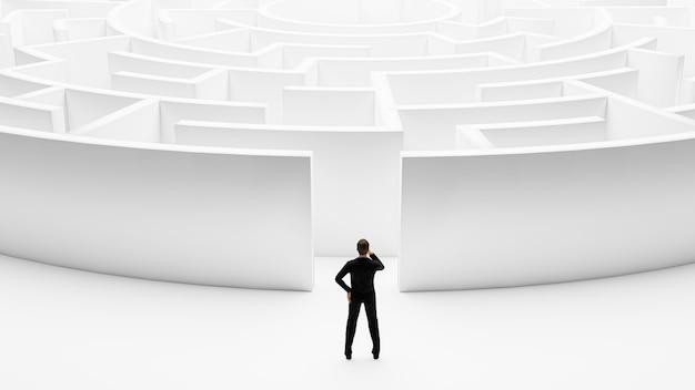 Rendering 3d. uomo d'affari 3d in piedi davanti al labirinto.