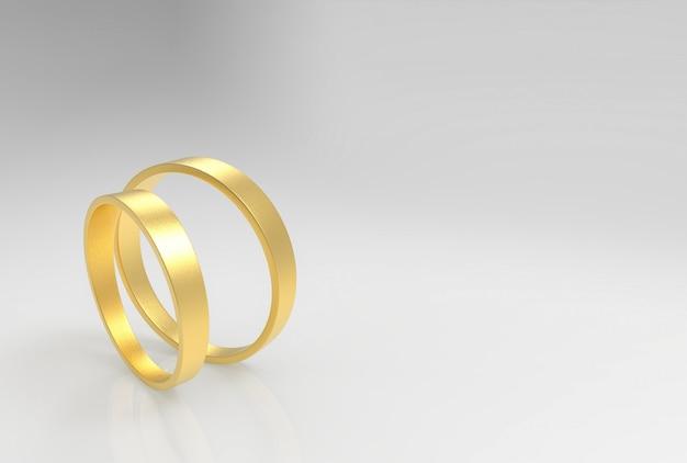 Rendering 3d. anelli dorati semplici di una coppia su fondo grigio.