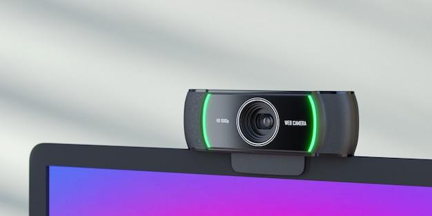 Oggetto di rendering 3d. primo piano della webcam posizionata sullo schermo del laptop e sulla parete blu con luce solare.