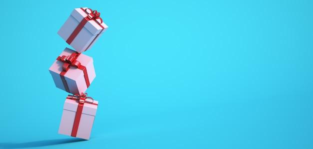 Rendering 3d di tre scatole regalo contro una superficie blu