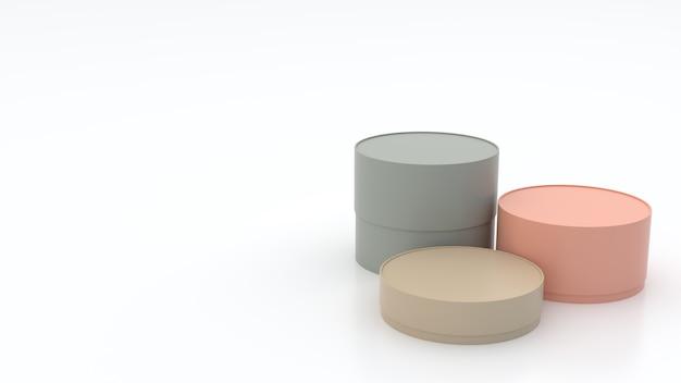 3 ° scatole cilindriche di varie dimensioni, colori pastello sul pavimento e bianco