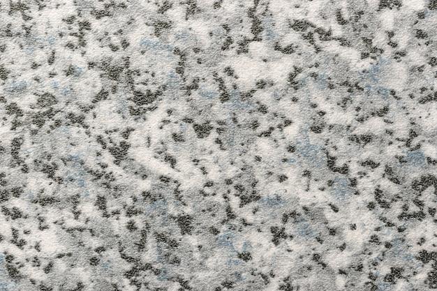 Sfondo di arte astratta di colore nero, bianco e grigio. texture del piano di lavoro in pietra con macchie blu