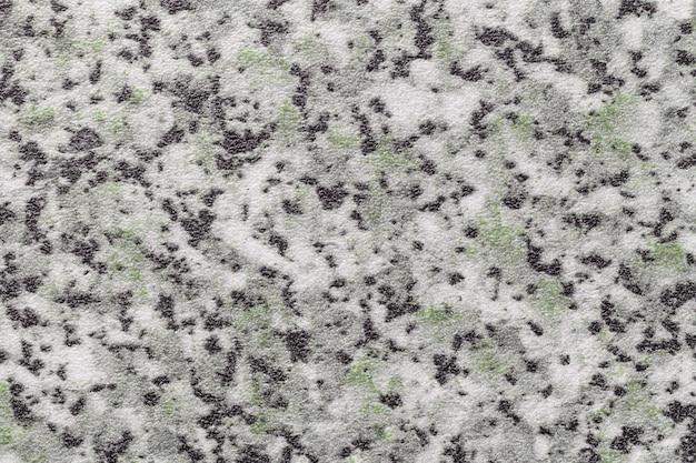 Sfondo di arte astratta di colore nero, bianco e grigio. struttura del piano del tavolo in pietra e del piano di lavoro con macchie verdi