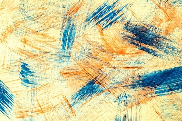 Colori blu e beige del fondo di arte astratta. dipinto ad acquerello su tela con pennellate di colore arancione e schizzi. opera in acrilico su carta con motivo maculato. sfondo di trama.
