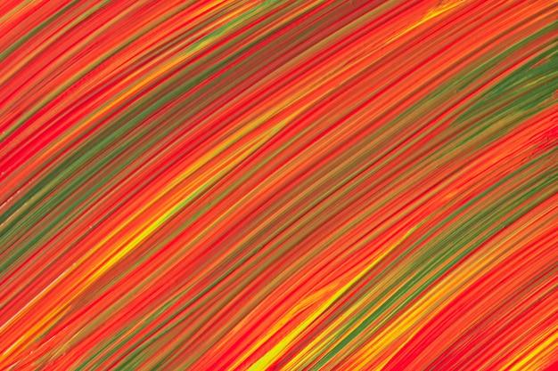 Colori rossi e verdi luminosi del fondo di arte astratta. dipinto ad acquerello su tela con pennellate gialle e schizzi. opera in acrilico su carta con motivo maculato. sfondo di trama.