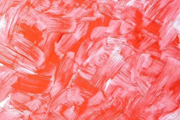 Colori rossi e bianchi luminosi del fondo di arte astratta. dipinto ad acquerello su tela con pennellate e schizzi. opera in acrilico su carta con motivo maculato di cielo. sfondo di trama.