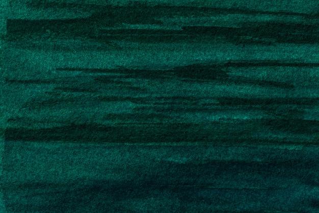 Arte astratta sfondo verde scuro e colori neri. dipinto ad acquerello su tela con morbida sfumatura smeraldo. frammento di opera d'arte su carta con disegno ciano. sfondo texture.
