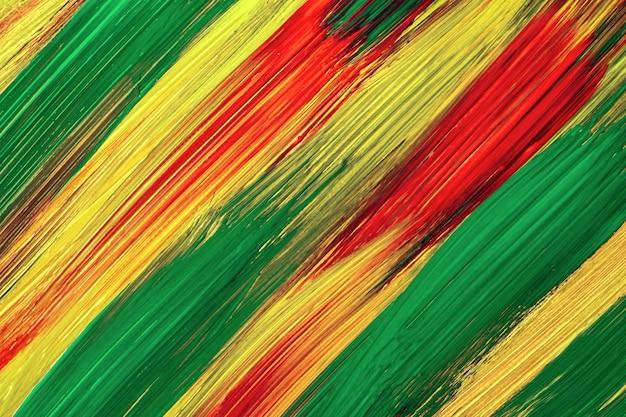Sfondo arte astratta colori verde scuro, gialli e rossi. dipinto ad acquerello su tela con pennellate e schizzi. opera in acrilico su carta con motivo maculato. sfondo di trama.