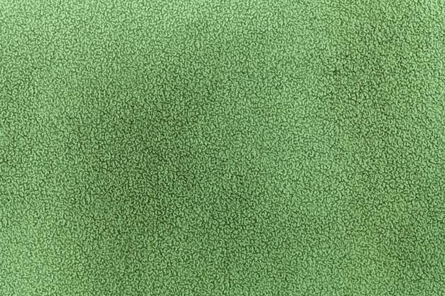 Colori verde chiaro del fondo di arte astratta. dipinto ad acquerello su tela con morbida sfumatura olivastra. frammento di opera d'arte su carta con motivo. sfondo texture.