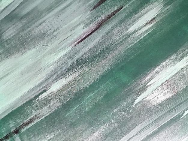 Colori verde chiaro e bianchi del fondo di arte astratta. dipinto ad acquerello su tela con sfumatura grigia. fondale in acrilico con motivo a pennellate.