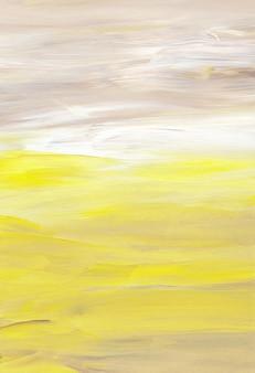Pennellate di sfondo artistico astratto, giallo, marrone, bianco su carta