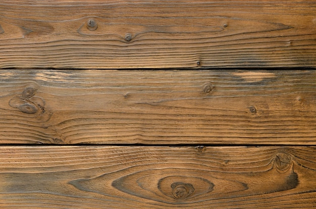 Fondo astratto della vista superiore del primo piano dei bordi di legno scuri wooden